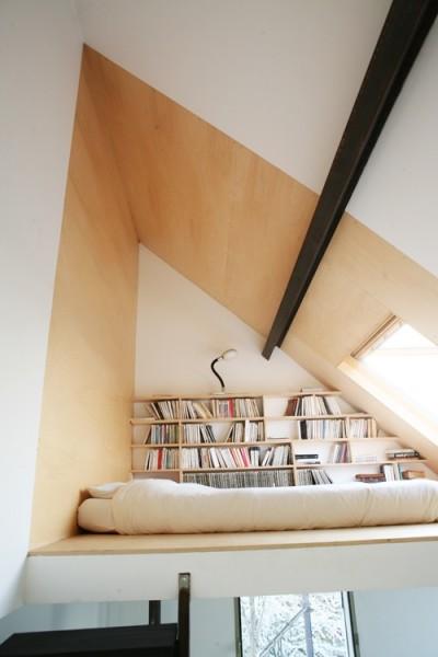 Tiny House Sleeping Loft with Books Shelves and Skylight